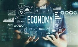 Экономика с молодым человеком стоковая фотография rf