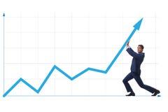 Экономический рост молодого бизнесмена поддерживая на диаграмме дела Стоковая Фотография RF