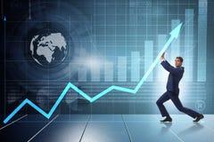 Экономический рост молодого бизнесмена поддерживая на диаграмме дела Стоковое фото RF