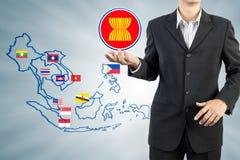 Экономическое сообщество АСЕАН в руке бизнесмена Стоковое фото RF