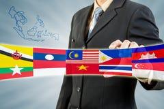 Экономическое сообщество ASEAN в руке бизнесмена Стоковое фото RF