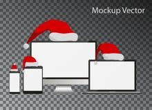 Экраны модель-макета с собранием шляп Санта Клауса изолировали темный ба Стоковые Изображения RF