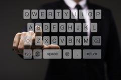 Экран бизнесмена касающий мнимый с кнопочной панелью Стоковые Фото