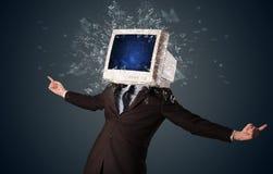 Экран монитора компьютера взрывая на молодые человек возглавляет Стоковое Фото