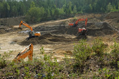 Экскаваторы начинают яму песка Стоковое Фото