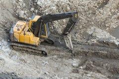 Экскаватор на земле на строительной площадке стоковое фото rf