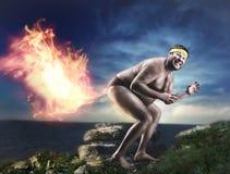 Эксцентричный нагой человек пукает пламя Стоковые Изображения RF