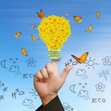 Электрическая лампочка и бабочки цветка Стоковое Изображение
