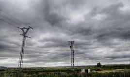 Электрические башни в шторме стоковое фото