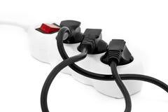 Электрический удлинитель при провода введенные в гнездо Стоковые Изображения