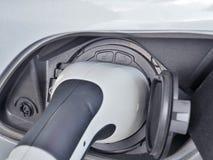 Электричество электротранспорта или автомобиля EV поручая стоковые изображения rf