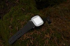 Электронный outdoors часов, устройства на земле стоковые фото