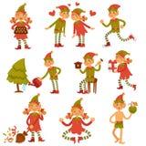 Эльфы рождества мужские и женские в праздничных одеждах бесплатная иллюстрация