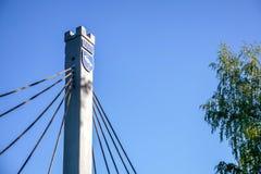 Эмблема городка мемориальная Visaginas Литвы с символом аиста и годом 1975 учреждения стоковое фото