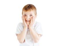 Эмоции выставки мальчика на белой предпосылке Стоковая Фотография RF