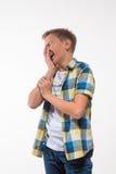 Эмоциональный мальчик в рубашке шотландки Стоковые Фотографии RF