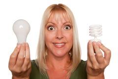 энергия шариков держит светлую регулярн женщину сбережени Стоковая Фотография RF