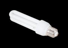 Энергосберегающая изолированная лампа на черной предпосылке Стоковые Изображения RF