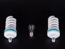 Энергосберегающая изолированная лампа на черноте Стоковые Фото