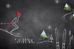 Эскиз лыжника и origami на черной доске Стоковая Фотография