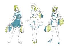 Эскиз с элегантными девушками с хозяйственными сумками Стоковое фото RF