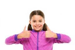 Это внушительно Большие пальцы руки вверх по approvement Большие пальцы руки шоу ребенка девушки милые вверх по жесту Подарки ваш стоковая фотография rf