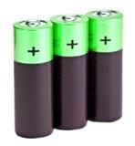 3 это черные зеленые типа пальц батареи размера AA на белой предпосылке Стоковые Изображения RF