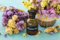 Эфирное масло с цветком Стоковые Изображения