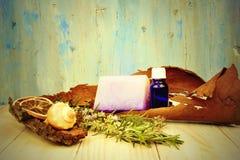 Эфирные масла деревенской предпосылки травяные Стоковая Фотография