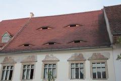 Эффектные румынские крыши с глазами в Трансильвании Стоковая Фотография RF