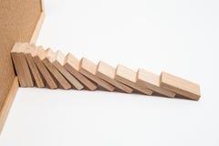 Эффект домино - строка белых домино на белой предпосылке Стоковое Фото