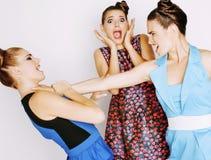 Элегантная женщина моды 3 воюя на белизне Стоковая Фотография