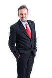 Элегантное и официально положение бизнесмена Стоковое фото RF