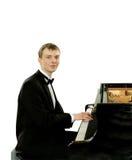 Элегантный молодой пианист рояля Стоковое Фото