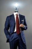 Электрическая лампочка на бизнесмене - концепции решения Стоковое Изображение