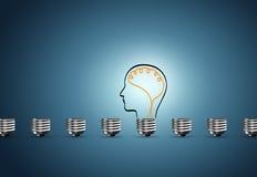 Электрическая лампочка на голубой предпосылке Стоковая Фотография RF