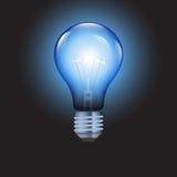 Электрическая лампочка на голубой предпосылке Стоковое Фото