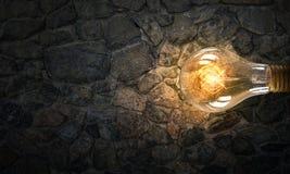 Электрическая лампочка на поверхности кирпича Стоковые Изображения RF