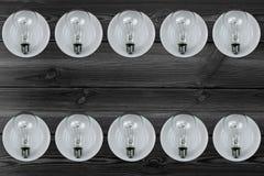 Электрическая лампочка на плите стоковое фото rf