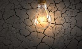 Электрическая лампочка на текстуре Мультимедиа Стоковые Фото