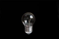 Электрическая лампочка на темной предпосылке Стоковое Изображение RF
