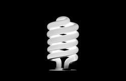 Электрическая лампочка на черноте Стоковое Изображение