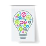 Электрическая лампочка с красочными шестернями внутрь на серой бумажной плате также вектор иллюстрации притяжки corel Стоковая Фотография