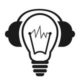 Электрическая лампочка с наушниками Стоковое Фото