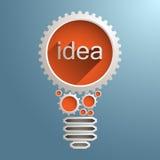 Электрическая лампочка с шестернями и cogs Стоковое Фото