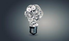 Электрическая лампочка с шестернями стоковое изображение