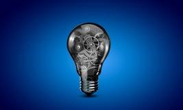 Электрическая лампочка с шестернями Стоковая Фотография RF