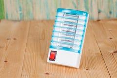 Электрическая ловушка москита изолированная на белизне стоковые фото