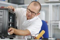 Электрическая печь портативной машинки проблемы Стоковые Изображения RF