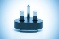 Электрическая штепсельная вилка изолированная Великобритания. синь обрабатываемая цветом Стоковые Изображения RF